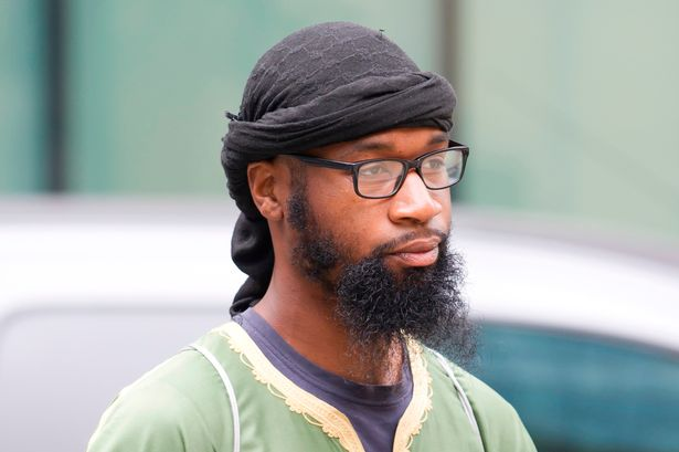 """UK: A Muslim convert said he wouldn't stand for """"any man"""" before his court hearing began, but stood"""
